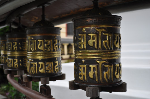 Prayer wheel. Tibetan Buddhists often carry a prayer wheel with a mantra (chant) inside on a strip of paper. Each turn of the wheel counts as a single prayer.