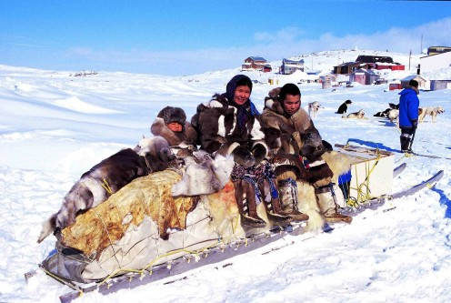 Inuits and a traditional qamutik  dog sled at Cape Dorset.