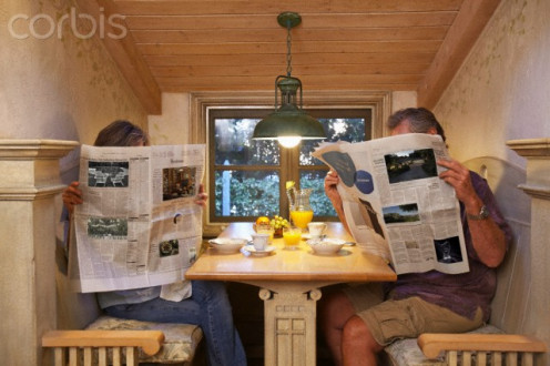 Hiding behind the newspaper can keep you from talking to the person you don't like.