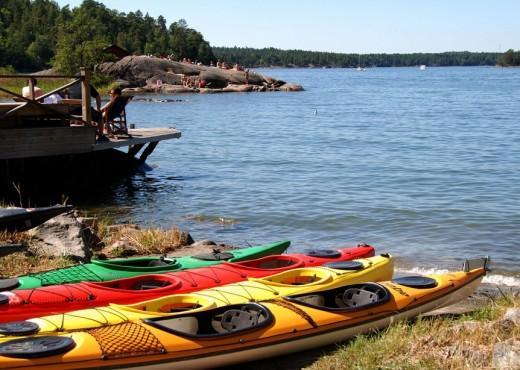 Four kayaks resting onshore