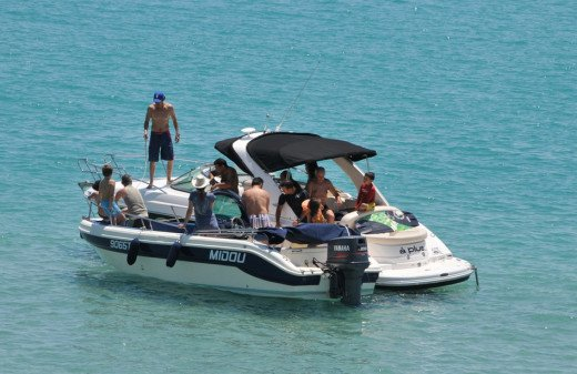 Friends and family enjoy time aboard a boat - however, I don't recommend living aboard one like this!