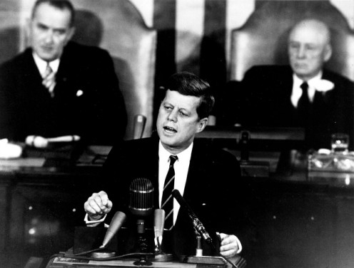 President John F. Kennedy speaking before the US Congress. V.P. Lyndon Johnson is on the upper left.