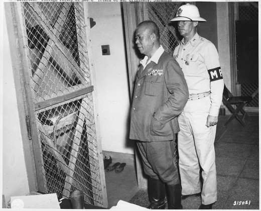 "A US MP returns Tomoyuki Yamashita, the ""Tiger of Malayasia"" to his cage after a day in court while on trial for war crimes."