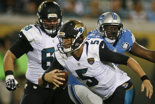 Jacksonville Jaguars quarterback Blake Bortles (5) runs away from Detroit Lions defensive tackle Tyrunn Walker (93) in the first quarter of a preseason NFL football game at EverBank Field. Mandatory Credit: Phil Sears -- USA TODAY Sports