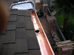 This is an example of a copper seamless gutter installed.  Photo by http://www.flickr.com/photos/copper-worx/655955264/