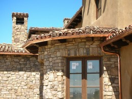 This absolutely beautiful looking gutter will patina well against this stone faced home.  Photo by http://www.flickr.com/photos/copper-worx/655887098/