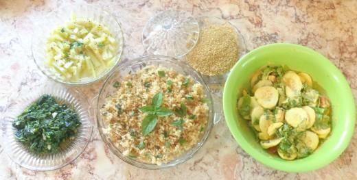 Quinoa served with long squash/thai bottle gourd, wild amaranth greens, gomasio condiment, and a salad.