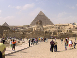 The ancient Egyptians built pyramids as burial sites for their pharaohs and their families. The Great Pyramid of Giza which was constructed  around 2580–2560 BC (4th dynasty) is the only one of the Seven Wonders of the Ancient World still standing.