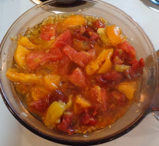 Fresh tomatoes cooking in garlic and oil