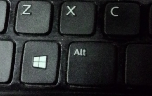 Windows key - somewhere at the bottom left of your keyboard