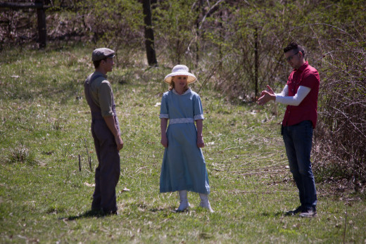 "Director Stephen Ruminski (right) guides actors Will Lott and Amanda Raudabaugh during the making of ""Belle"" -- a short movie about murders in the Heartland."