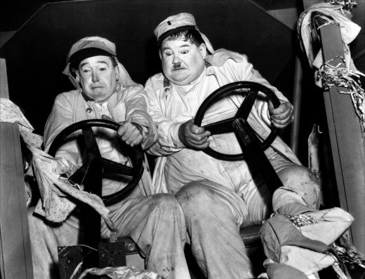 """Well, here's another nice mess you've gotten me into."" Laurel and Hardy: scene from ""The Flying Deuces"" 1939"