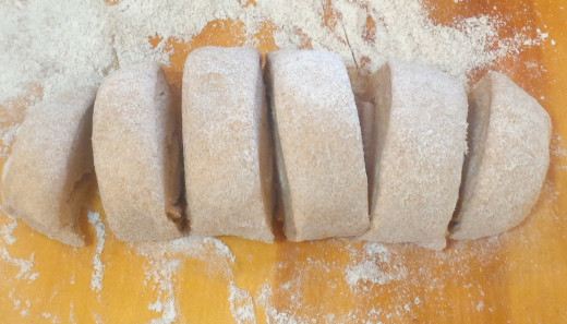 Risen dough cut into smaller pieces for making pita bread