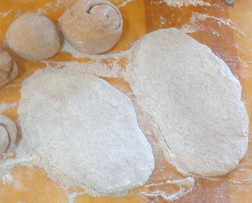 Dough rolled flat prior to baking