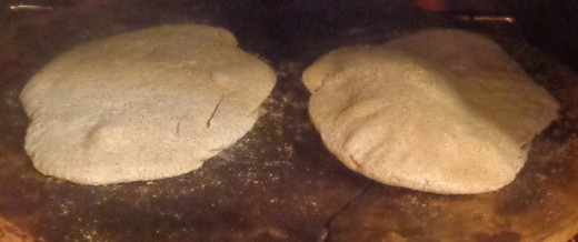Pita bread baking on a bake stone