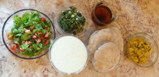 Here's an idea for a meal: serve your home made pita bread with tzaziki, zucchini tomato sauce, cooked greens, salad and herbal tea.