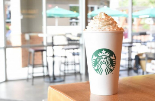 Enjoy a pumpkin spice latte at Starbucks.