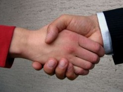 How did hand shaking originate?