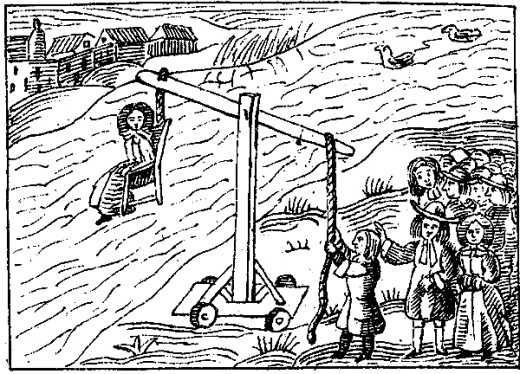 A women about to be dunked by the ducking stool.