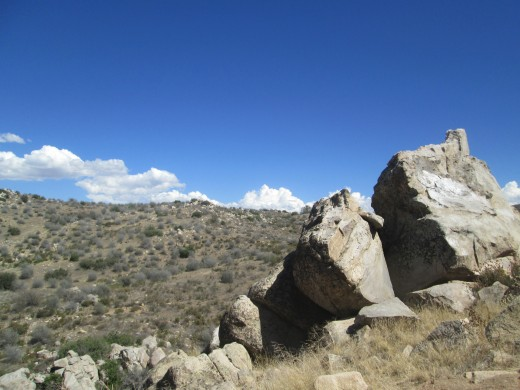 The boulders are at the top of the hill.
