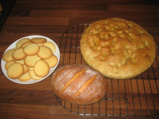 I was running low on flour, but did not see this as any reason to compromise. The right is simple butter biscuits, the left is 5 min bread cooked in a large cake tin with sun dried tomatoes mixed into the dough, the centre loaf is a small brioche