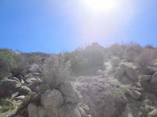 The sun is shining down on the boulders.