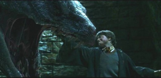 Harry Potter slays the Basilisk; gets bitten in the process