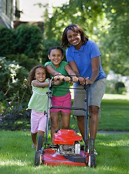 Sometimes mowing grass can be a family affair.