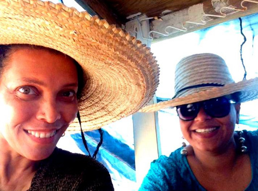 In Grand Cayman with Glennis, friends since age 11.  Trying on various straw hats!
