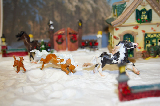 Some of my own model horses in a diorama setting.