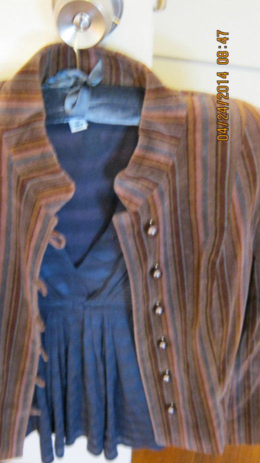 Brown striped blazer over blue top.