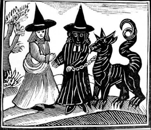 "A witch meeting with the ""black"" magician and his familiar."
