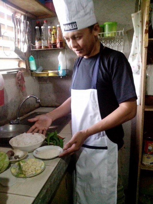 This is me, preparing my ingredients for HOT & SPICY PILI NUTS in CABBAGE ROLLS. Photo Source: Ireno Alcala