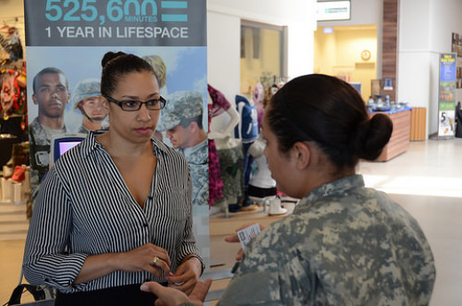 Sgt. Yesenia Albiter, right, a Force Health noncommissioned officer assigned to Katterbach Army Health Clinic, talks health issues with Stacy Drones, left, a contractor who had just had her blood pressure checked during the Army Performance Triad kic