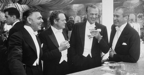 Hollywood Elite: Gregory Peck and his buddies at a cocktail party.