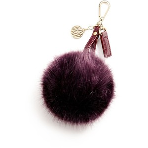 A purple faux fur pom pom key ring