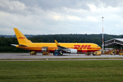 A DHL cargo plane in Thailand. International courier firms are the best option when sending medium sized parcels
