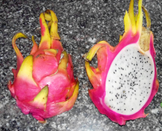 Dragon fruit cut into two pieces.