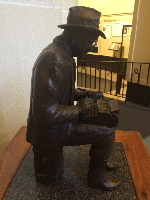 Sculpture of Will Rogers on typerwriter