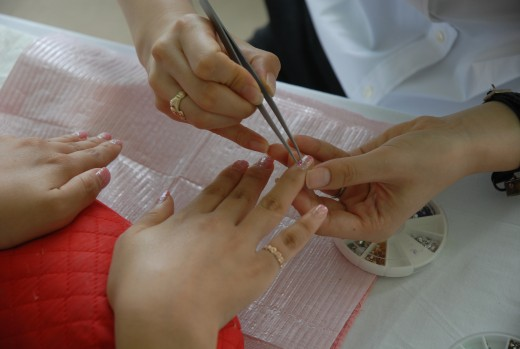 Manicuring or trimming and shaping of nails being done at a salon