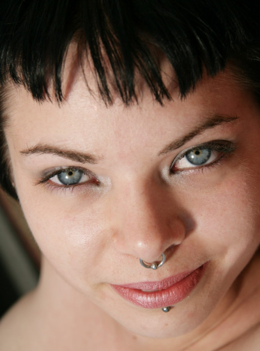 Woman with septum piercing and labret piercing