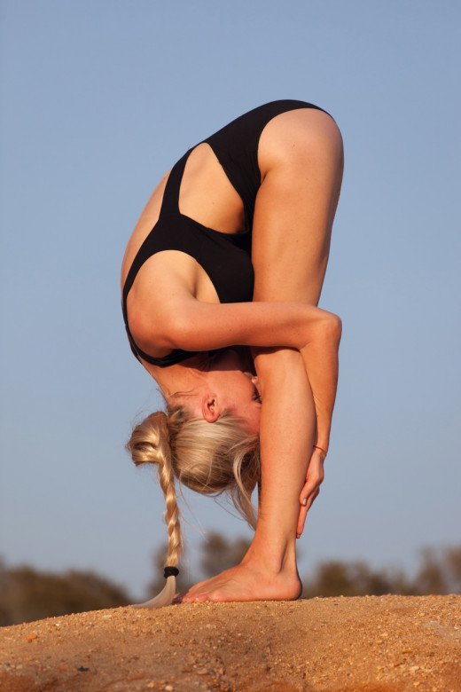 Standing Forward Fold (Uttanasana) is a popular yoga pose that deeply stretches the hamstrings.