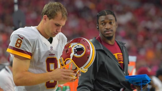 Washing Redskins QB Kirk Cousins (L) and Bench-warmer Robert Griffin III (R)