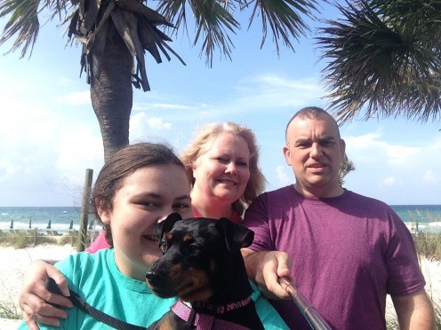 Practice with your selfie stick to learn the best angle to fit every member of the family into your beach pic.