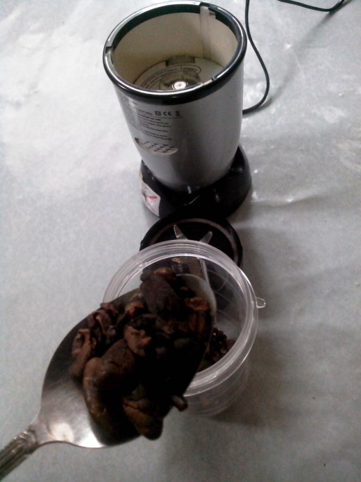 Grounding the Cacao Beans (Photo Source: Ireno Alcala)