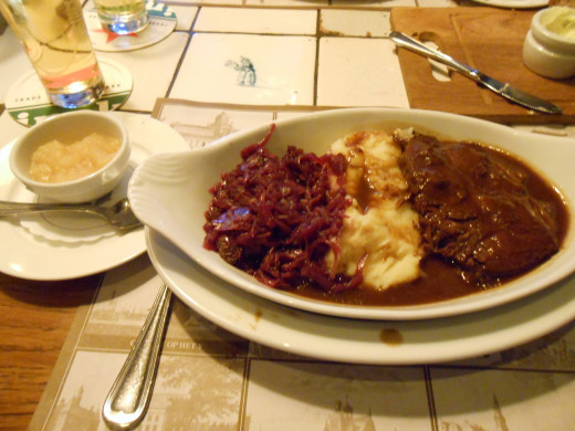 "My typical Dutch meal. This was called ""Beef Stew"" and it was served with apple sauce. That's red cabbage on the left, mashed potatoes in the middle and beef with gravy on the right."