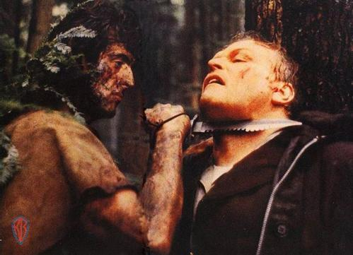 "Stallone (left) and Dennehy face off in ""First Blood""..."