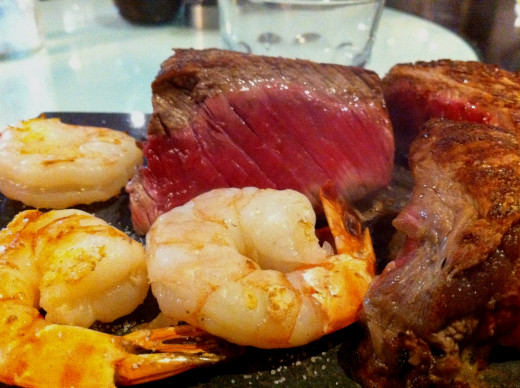 'Surf and Turf' is a classic barbecue dish that combines the taste of rare-cooked steak with prawns and shrimp