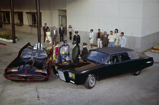 "The Batman/Green Hornet crossover episode, ""A Piece of the Action/Batman's Satisfaction:"" Foreground (left to right): Burt Ward as Robin, Adam West as Batman, Van Williams as Britt Reid and Bruce Lee as Kato with the Batmobile and ""Black Beauty."""