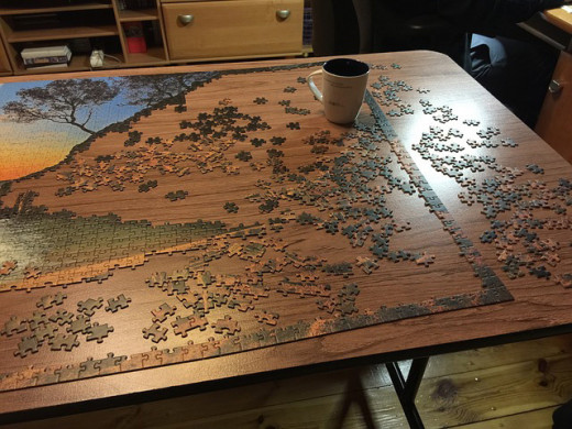 Jigsaw puzzle on a table.